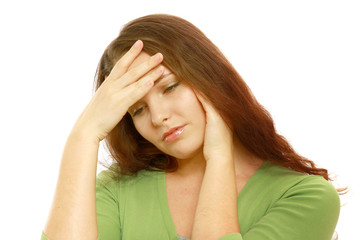 A woman with a headache holding her hand