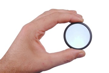 man hand holds a circular polarizer filter, isolated on white