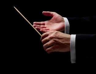 Hands of a conductor on black background