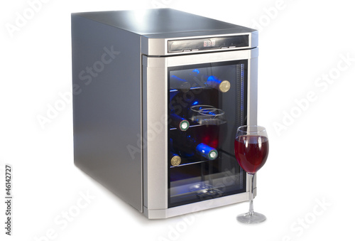 Poster Wine refrigerator and glass of red wine.