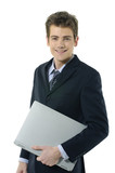 Smart young business man holding a laptop