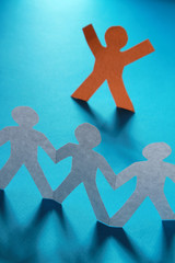 Colored paper people, isolated on blue