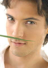 Close up Man smelling a green leaf