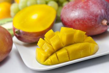 Mango and fruits on the plate closeup