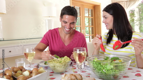 Couple Eating Meal Together In Dining Room