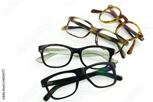 Leinwanddruck Bild Brillengestelle rund angeordnet