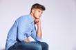 pensive fashion young man