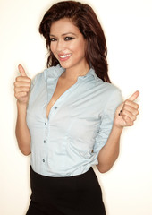 Young beautiful businesswoman with thumbs up