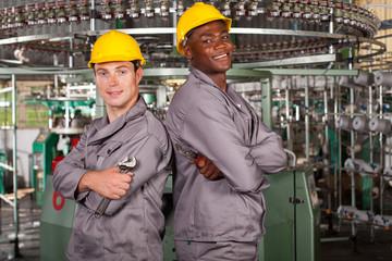 two textile industrial technicians portrait in factory
