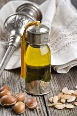 Bottle of Argan oil and fruits