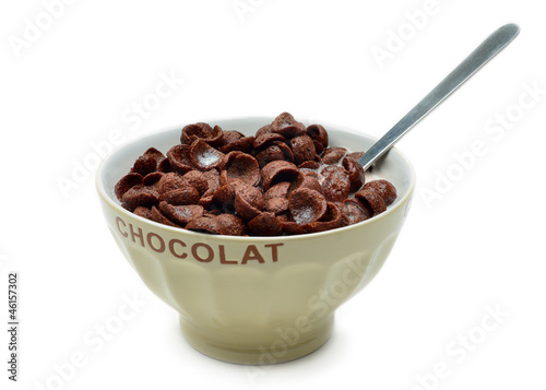 Bowl with chocolate cornflakes, cereals and milk