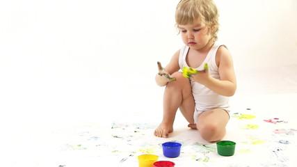 boy painter in the studio