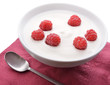 Bowl of white yoghurt with fresh raspberries