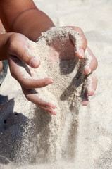 sand flowing from the hand