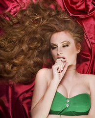 Young beautiful girl with long hair lying on the floor