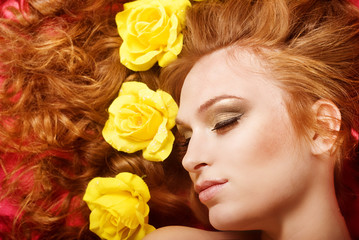 red haired nice caucasian girl with yellow flowers in hair