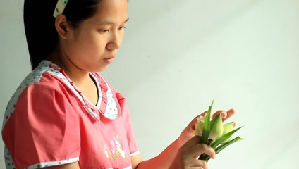 Woman folding lotus for buddha monks,HD clip,thailand.
