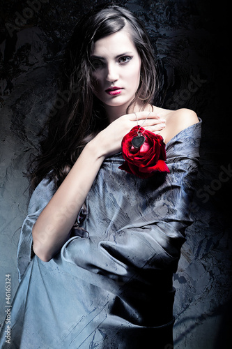 woman in grey fabric with red rose