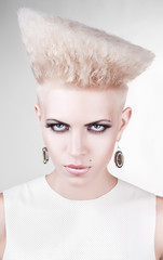 close-up portrait of agressive punk blond woman