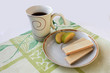 Cup of tea and wafers isolated on green cloth