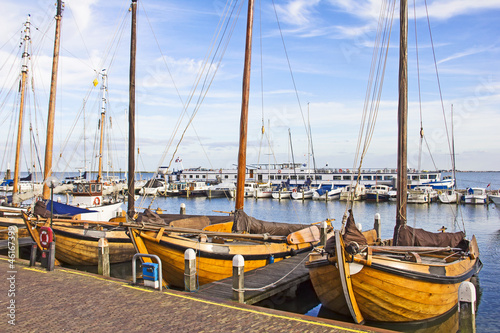 Old boats in the port of Volendam, The Netherlands