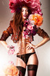 pretty gorgeous erotic woman in brown jacket and big flowers