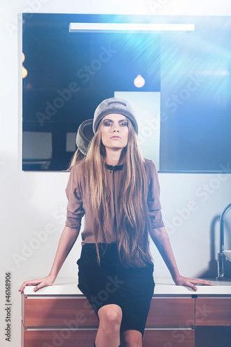 Glamour woman sits on washstand