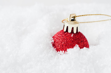 Red Christmas Bauble in Snow