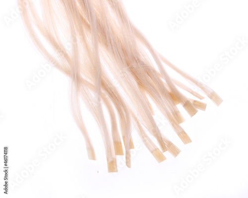 keratin capsules of blonde hair extensions isolated