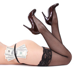 sexy legs and dollars isolated on white