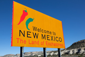"Yellow ""welcome to New Mexico"" sign"