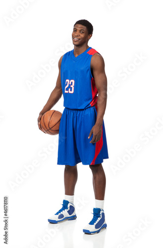 A young African American basektball player in uniform