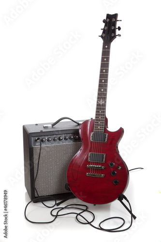 An electric guitar and amp on a white background with copy space