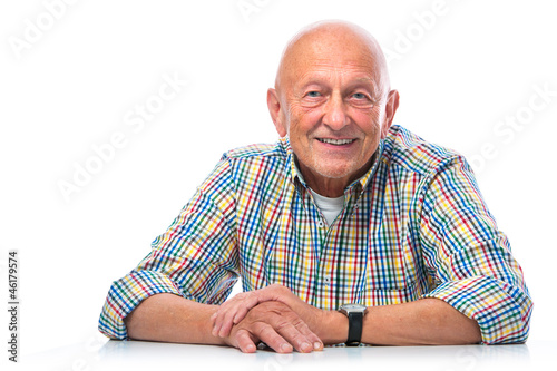 Portrait of a happy senior man smiling