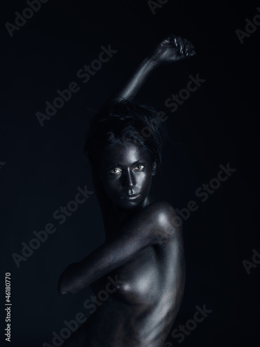 artistic nude woman painted black, black background - 46180770