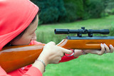 Young woman shooting with airgun