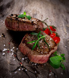 Fototapety Grilled bbq steaks with fresh herbs and tomatoes