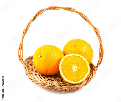 Ripe orange fruits in a wicker basket