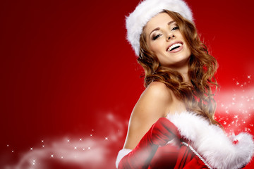 Beautiful woman wearing Santa Claus hat smiling to camera