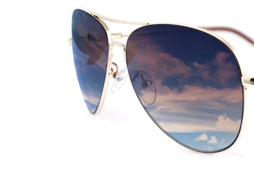 Side view of aviator woman sun glasses with sky reflection isola