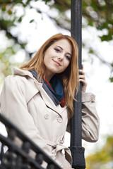 Beautiful girl at autumn outdoor.