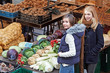 two young women at a market stand