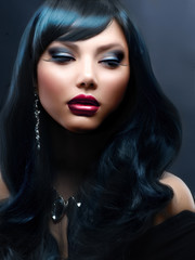 Beautiful Woman With Black Hair and Holiday Professional Makeup