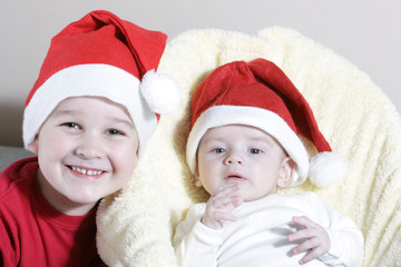 Beautiful child and newborn with Christmas hat