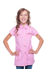 cheerful little girl in pink shirt posing