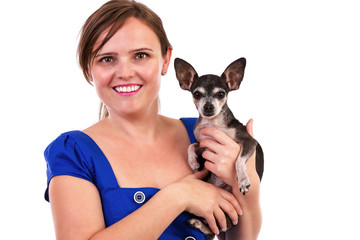 Portrait of a young woman holding her chihuahua dog