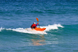 Man paddling a Sea kayak