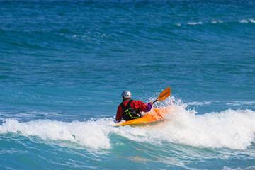 Man paddling a Sea kayak
