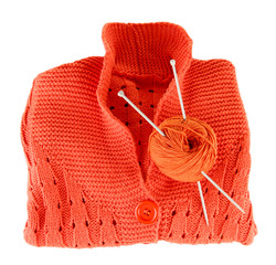 Orange sweater and a ball of wool isolated on white