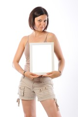 Beutiful girl holding a blank and white frame